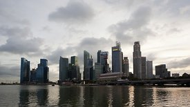 Wide Shot: Scattered Clouds & A Neon Lit Sunset, Downtown Singapore