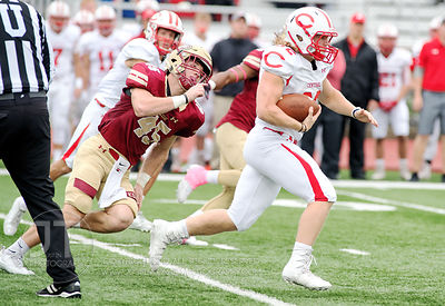 Coe College's Jacob Elsbury (45) chases Central's Nathan Fitzgerald (32) during the first half of play at Clark Field in Ceda...