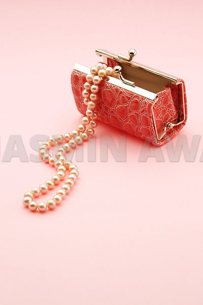 Pink Purse with Pearl Necklace