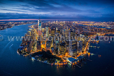 Aerial view of Lower Manhattan lit up at night