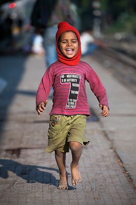 A boy from a shelter at Sealdah Station, Kolkata, India plays near the tracks. Sealdah is one of the largest train stations i...