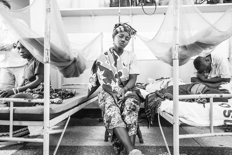 A mother sits with her child in Sekou Toure ICU paediatric unit of Sekou Toure Hospital, on Lake Victoria, northern Tanzania....