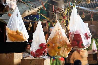 Bags of peppers hang from the ceiling at the indoor veg market at Newmarket, Kolkata, India.