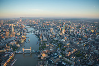 Aerial view of  City of London with River Thames and Tower Bridge.