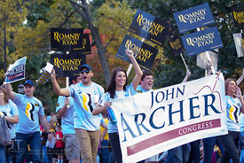 Republican supporters parade down Clinton St during the  University of Iowa homecoming Parade in Iowa City on Friday Septembe...