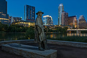 Stevie Ray Vaughan Statue and Austin Skyline