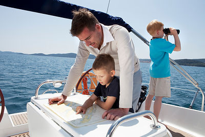 Father and sons on yacht