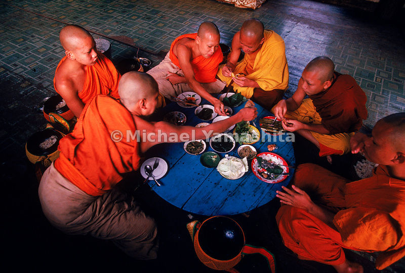 Young monks share a communal breakfast at Wat Xieng Thong, after their daily ritual of binthabat, or rice collecting, through...