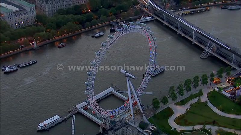 Aerial footage of the London Eye on the bank of the River Thames, London, England, UK