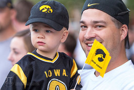 Jeremiah Lane, 2 and father Thad spectate the University of Iowa homecoming Parade on Clinton St in Iowa City on Friday Septe...