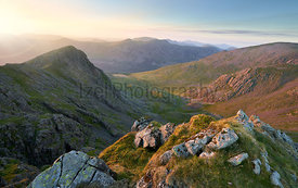 Sunset over Ennerdale from Scoat Fell views of Steeple and Pillar In the English Lake District, UK.