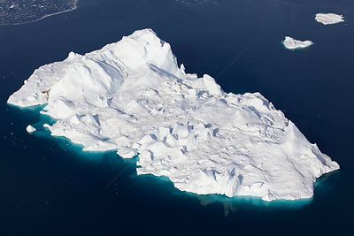 Aerial view of an iceberg in the Ilulissat Icefjord, where the Sermeq Kujalleq Glacier or Jakobshavn Isbrae enters the sea, n...