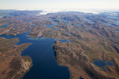 Aerial view of the landscape of the south-west coast of Greenlandbetween Kangerlussuaq and Ilulissat, with glaciers stretchin...