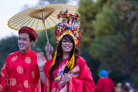 Members of the Vietnam Student Association wave during the  University of Iowa homecoming Parade on Clinton St in Iowa City o...