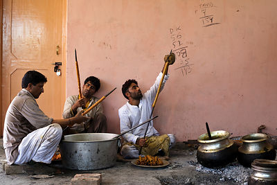 India - Srinagar - Wazas or cooks in the Wazwan tradition prepare kebabs in preparation for a Wazwan feast