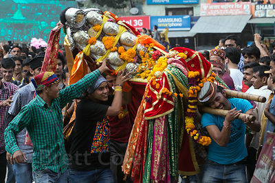 Men carry an idol of Lord Raghunath during the Dussehra festival in Kullu, India