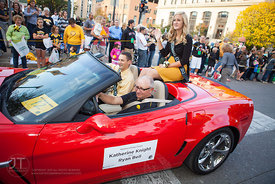 Homecoming Court members Katherine Knight and Ryan Bell are escorted along the parade during the University of Iowa homecomin...