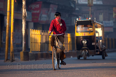 Cyclist guarding against the terrible air pollution in Jodhpur, Rajasthan, India
