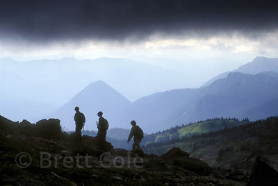 Hikers descend Mount Rainier as a storm approaches, Washington State.