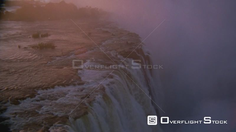 Aerial side view of waterfall and thick mist in gorge below Victoria Falls Zimbabwe