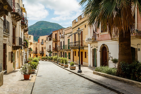 Attractive street of pastel coloured houses in Lipari, Italy