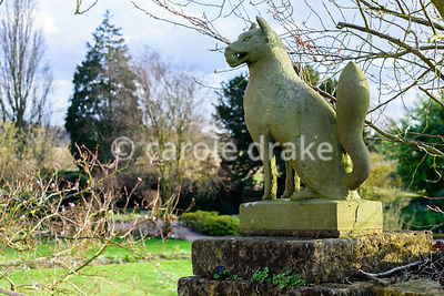 Stone animals frame steps leading down from the terrace around Hodsock Priory, Blyth, Notts into the garden