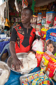 Young man selling goods in the market, Ghana