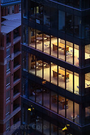 Aerial view of illuminated offices in a highrise, Baltimore, Maryland