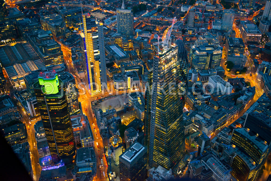 Aerial view of office buildings in the City at night, London