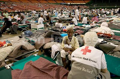 Red Cross volunteer comforts Hurricane Katrina survivor in Houston Astrodome