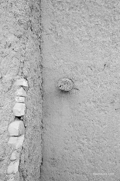ADOBE WALL DETAIL NORTHERN NEW MEXICO BLACK AND WHITE VERTICAL