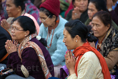 Buddhist pilgrims pray near the Dhamekh Stupa, Sarnath, India.