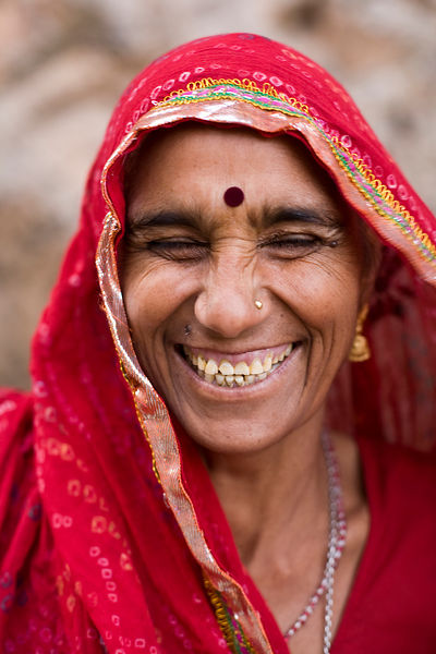 India - Rajasthan - A woman laughing at the Surya Mandir (known as the Monkey Temple)