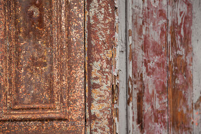 Weathered paint on wooden door