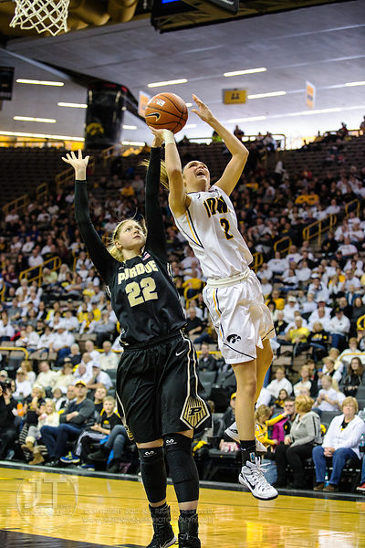 Iowa's Aly Disterhoft (2) drives to the basket versus Purdue's Bree Horrocks (22) during the first half of play at Carver-Haw...
