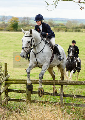 Juliet Cursham jumping onto Bruce's Lane. The Cottesmore Hunt at Somerby