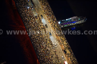 Aerial view of crowd on London Bridge at night
