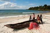 Children and dugout canoe on the beach, Chintheche, Malawi