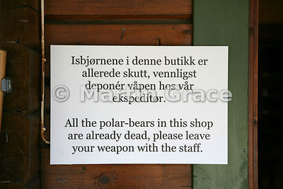 Sign about guns on shop door in Longyearbyen, Svalbard
