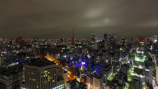 Bird's Eye: Tokyo Tower Ignites A Sky Of Clouds
