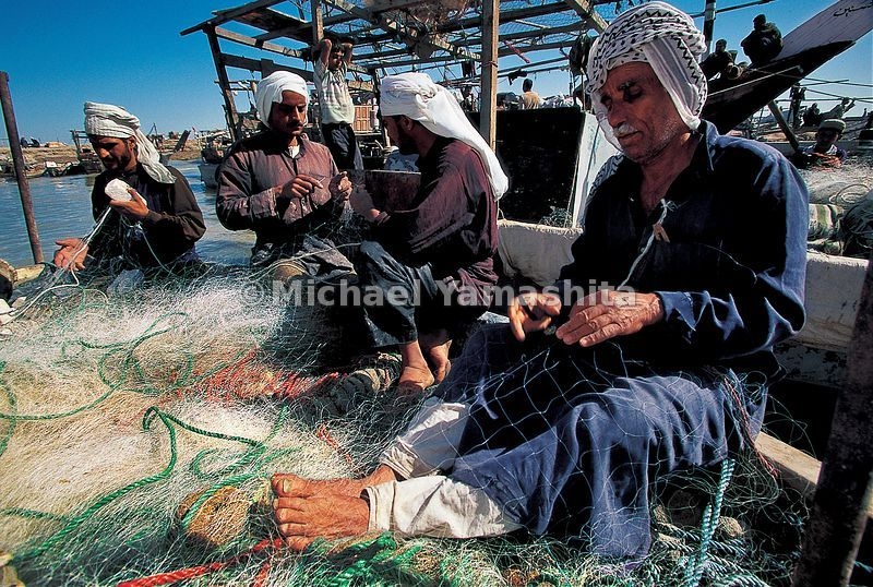 Persian Gulf fishermen mend their nets in Basra. Even though over half of the world's oil reserves are here, fishing has rema...