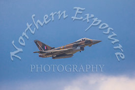 A RAF Typhoon Eurofighter climbing amongst blue skies and white clouds. This was taken at the 75th anniversary Airshow held a...