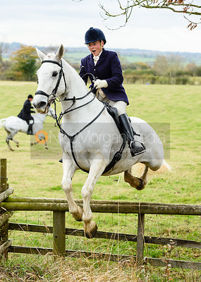Jo Rutter jumping onto Bruce's Lane. The Cottesmore Hunt at Somerby