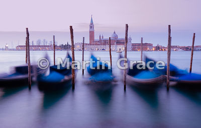 Dawn view of gondolas moving on the swell of Bacino di San Marco (St Mark's Basin), with San Giorgio Maggiore (church) beyond...