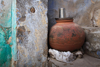 Still life of a weathered wall and clay pot, Pushkar, Rajasthan, India