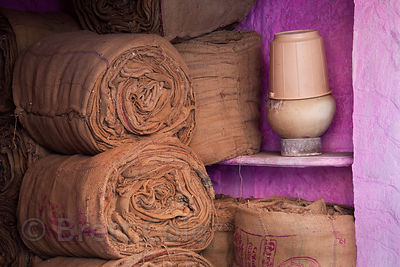 Burlap sacks in a striking purple room at a market in Jodhpur, Rajasthan, India