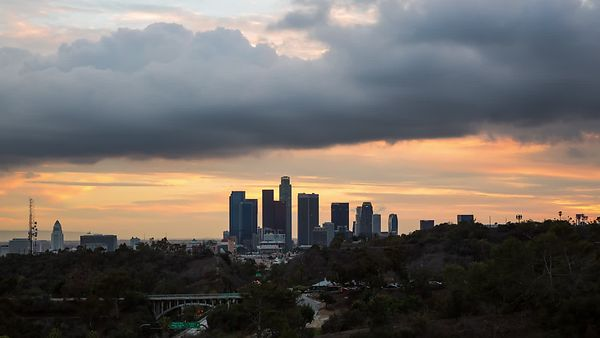 Wide Shot: Misty Marine Layer Clouds Rolling In Over A View of Downtown L.A. From Elysian Park (Day To Night)