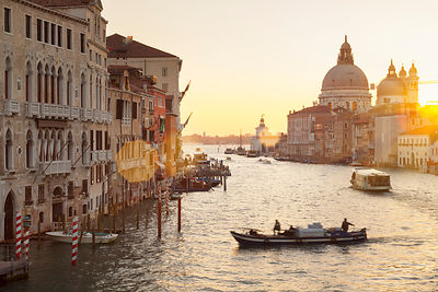 Italy, Venice, Morning traffic on Canal Grande at Santa Maria della Salute church