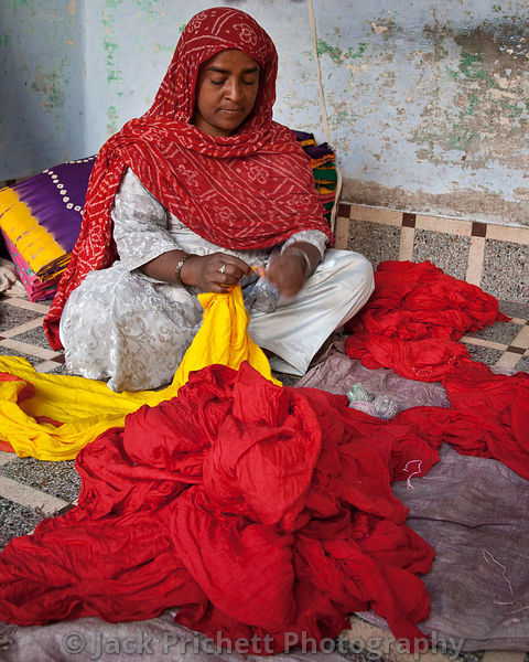Rajhastani woman sorts and prepares dyed cloth.