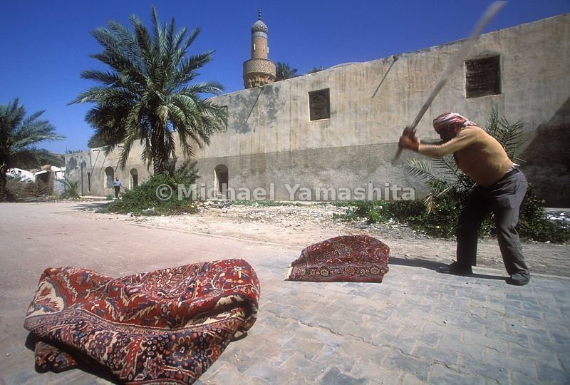 Carpet souk, washing and drying carpets.